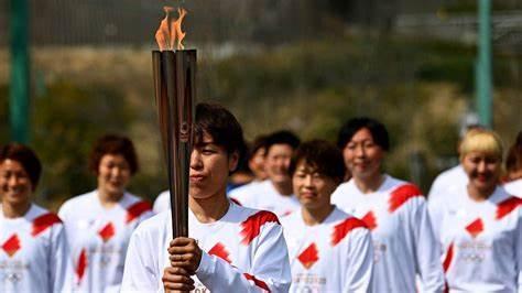 东京奥运圣火传递开启.jpg